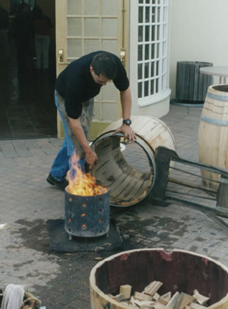Corporate wine group barrel demonstration